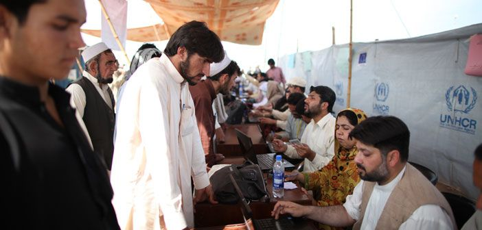 A man from Khyber Agency registers his family with UNHCR staff at Jalozai camp, Pakistan