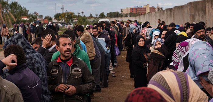 Syrian refugees await registration at the UNHCR compound in Tripoli, Lebanon.