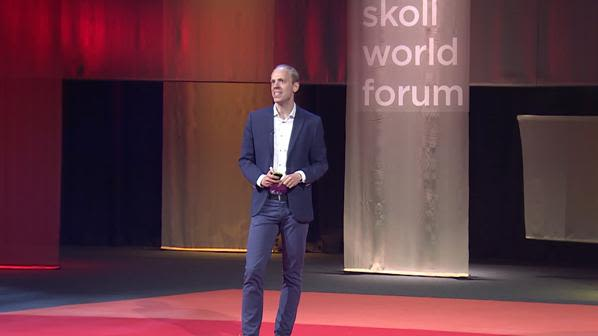 Alexander betts speaks at the skoll world forum on 2018refugees as a resource2019