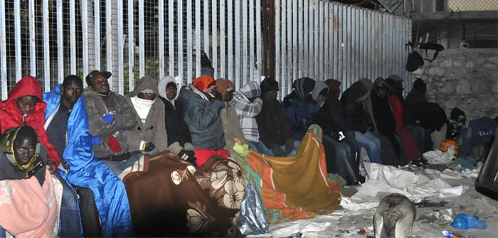 Lines of people sleep rough on Petrou Ralli Street in Athens in a queue to apply for asylum