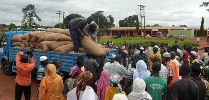 A local faith community unloads food aid in Tamale, Ghana