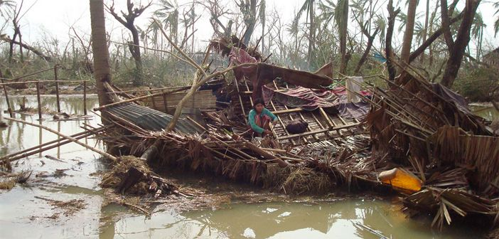 Cyclone survivors in Myanmar shelter in the ruins of their destroyed home
