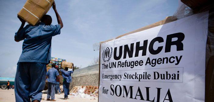 Boxes are loaded onto trucks for transport to Al Adala settlement, Somalia