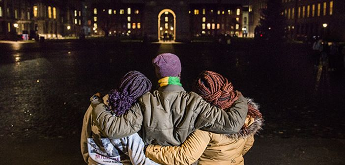 A family from the DRC now in Ireland hug while viewing the lights at night