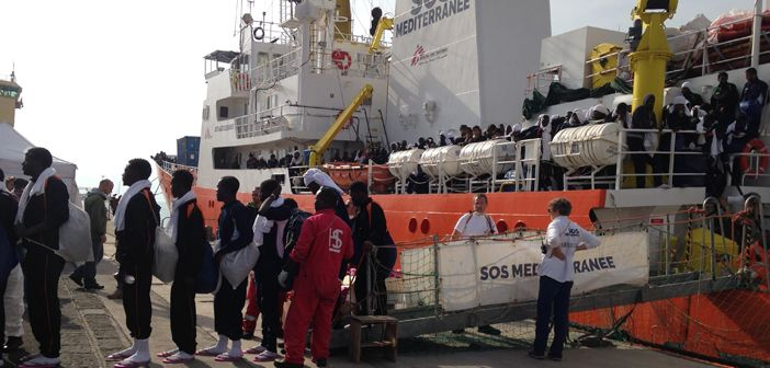 refugees and migrants disembarking from the SOS Mediterranee ship in Catania, Sicily