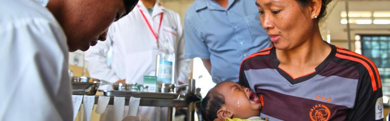 A local healthcare worker takes a blood sample from a feverish child in the Pailin hospital, western Cambodia – an area where the latest highly resistant P. falciparum malaria strain originated.