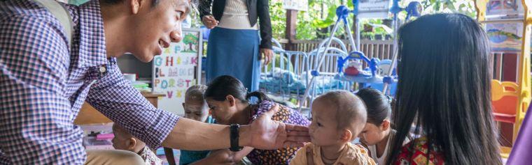 MOCRU researcher Myo Maung Maung Swe visiting children in Myanmar