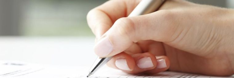 Person using pen to write