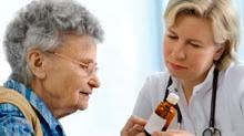 Photograph of doctor with patient