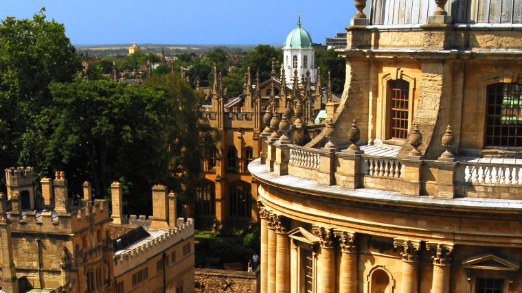 A photo of the Oxford skyline on a sunny day showing the Radcliffe Camera and surrounding buildings