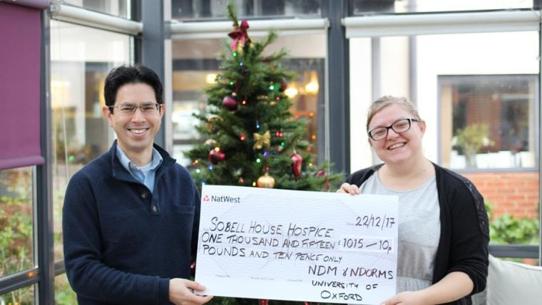 A photo of the cheque presentation of £1015.10 to Sobell House