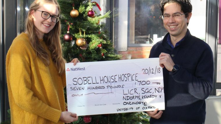 A photo of the cheque presentation of £700 to Sobell House