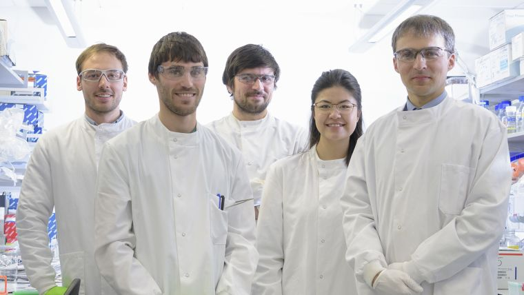 A photo of Skirmantas Kriaucionis and his 4 lab members posing for a group photo in the laboratory