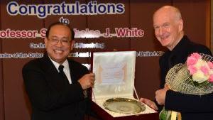 Nick White receiving an award