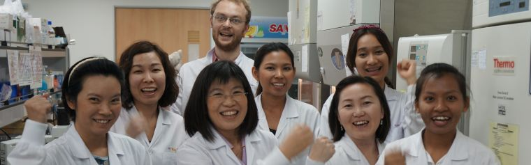 Group photo of researchers in a lab
