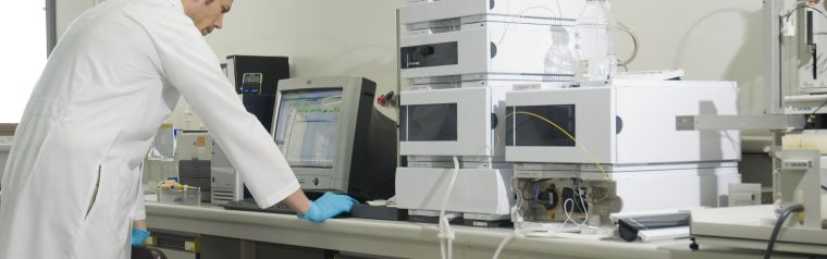 Scientist in a lab at a computer