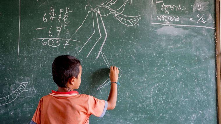 Child drawing on a blackboard