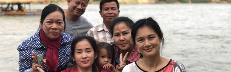 Head of Bioethics & Engagement Phaik Yeong Cheah with team members and locals at a Cambodian river crossing