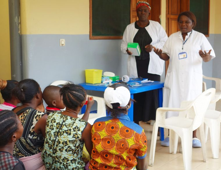 Health care workers sharing information about malaria to locals