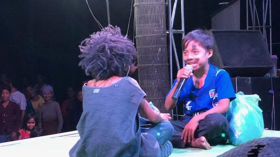 2 children on stage during a theatre performance
