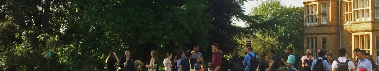 A photo of people in groups outside chatting to each other