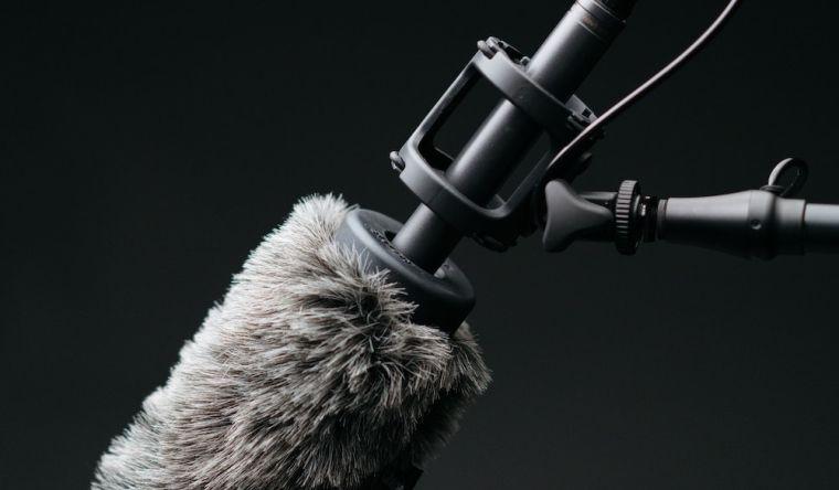 Film studio microphone on a long reach boom