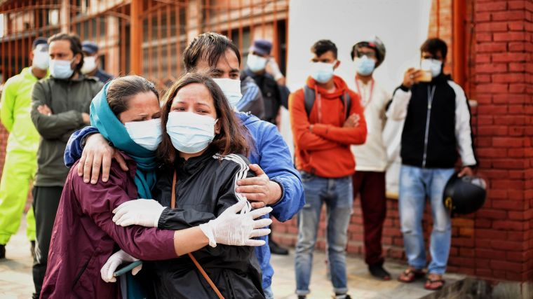 Mourners wearing masks on a Nepali street