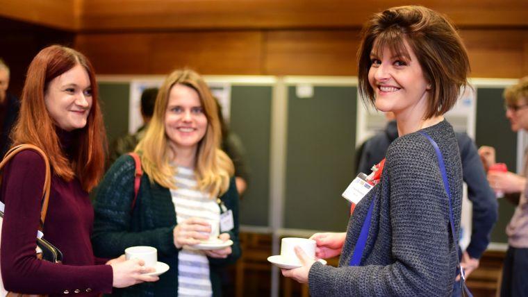 Photo of the 2019 MRC WIMM Postdoc Symposium, showing three postdocs smiling.