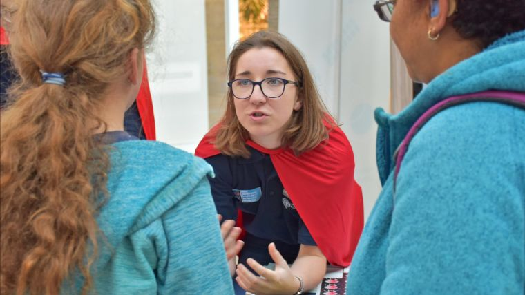 A MRC WIMM researcher talks to visitors at our cancer immunotherapy stand, part of the 2019 Oxford Science and Ideas Festival.
