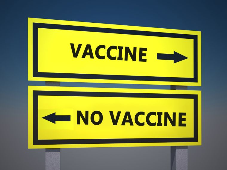 Signs pointing in opposite directions, one with Vaccine and one with No Vaccine written on them