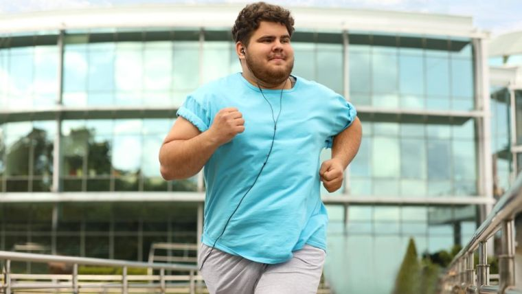 Overweight man jogging outside