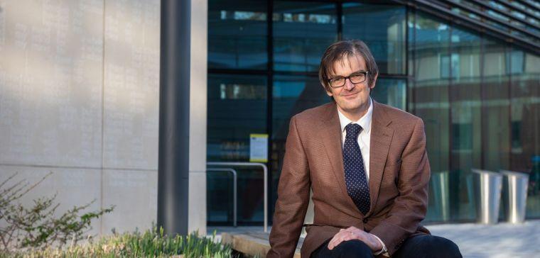 Professor Martin Landray sitting outdoors