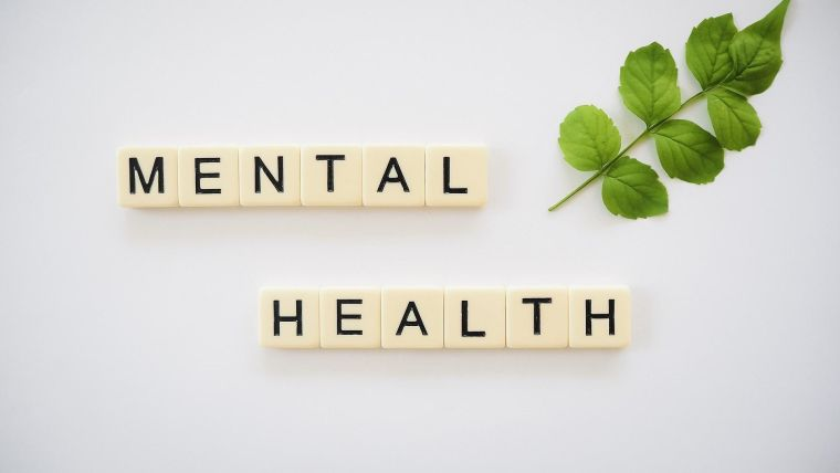 Photo of tiles arranged to say 'mental health'