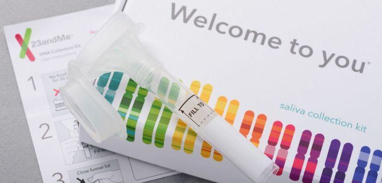23andMe personal genetic test saliva collection kit, with tube, box and instructions