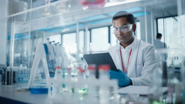 Medical Research Laboratory: Portrait of Male Scientist Using Digital Tablet Computer to Analyse Data. Advanced Scientific Lab for Medicine, Biotechnology, Microbiology Development