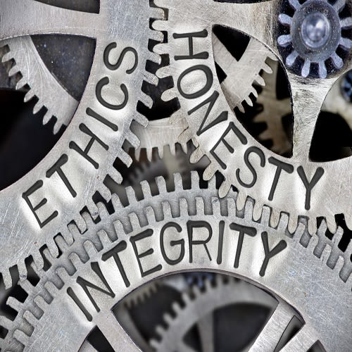 Cogs with the words ethics, honesty and integrity written on them.