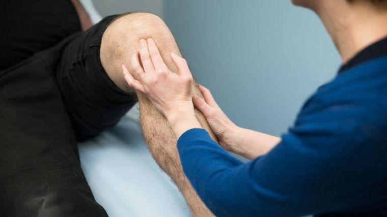 Patient having knee examined