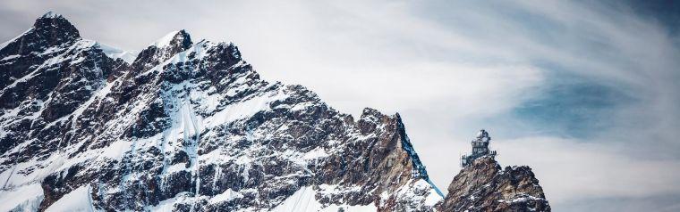 A row of snowy mountain peaks
