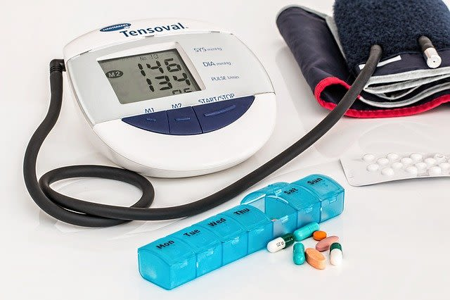 Photo of blood pressure monitor and medication