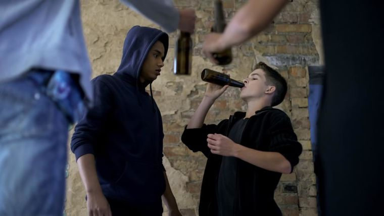 Alcohol consumption among youth, friends forcing boy to drink beer, bad company