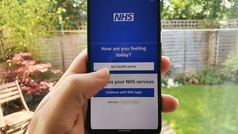 A phot of the NHS app being used.