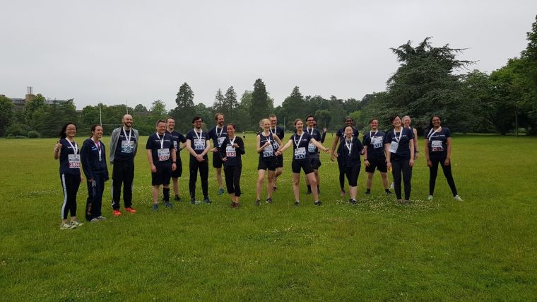 Group picture of smiling runners wearing their medals