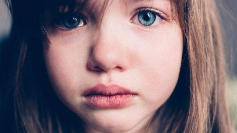 Young child with tearful eyes