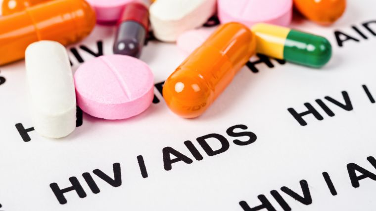 Selection of pills and the words 'HIV/AIDS'
