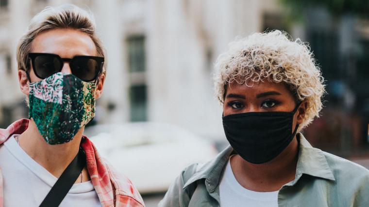 A couple wear masks