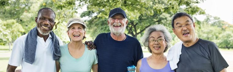 A group of older people smiling after exercising