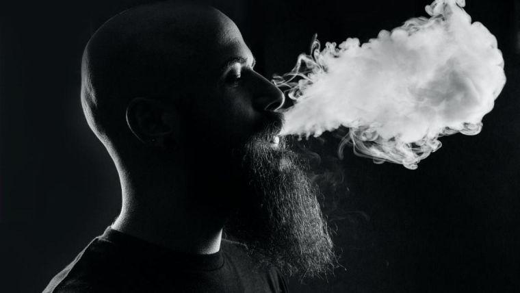 Man exhaling smoke from vape