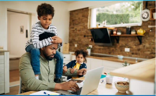 Father working from home with two children