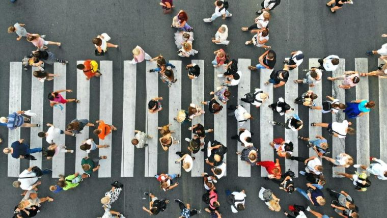 Aerial view of people walking across a pedestrian crossing