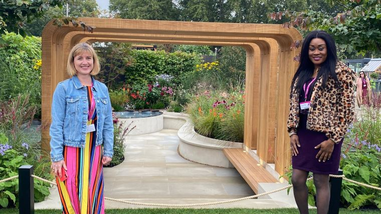 Katy Mimpress, Matron at the Emergency Department at the John Radcliffe Hospital, and Ade Adegboyega, Ward Sister for the John Warin Ward stood in the garden at the RHS Chelsea Flower Show